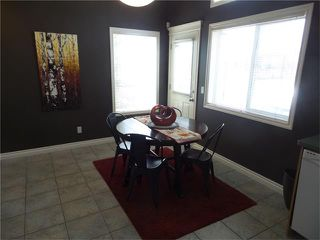 Photo 8: 97 CRYSTAL SHORES Cove: Okotoks House for sale : MLS®# C4113551
