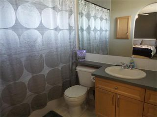 Photo 16: 97 CRYSTAL SHORES Cove: Okotoks House for sale : MLS®# C4113551