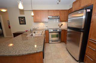 "Photo 4: 119 19673 MEADOW GARDENS Way in Pitt Meadows: North Meadows PI Condo for sale in ""The Fairways"" : MLS®# R2228449"