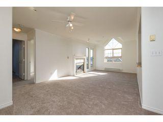 "Photo 3: 404 15325 17 Avenue in Surrey: King George Corridor Condo for sale in ""Berkshire"" (South Surrey White Rock)  : MLS®# R2241475"