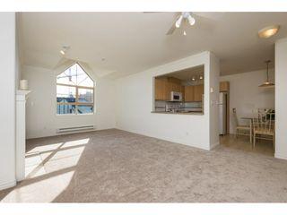 "Photo 5: 404 15325 17 Avenue in Surrey: King George Corridor Condo for sale in ""Berkshire"" (South Surrey White Rock)  : MLS®# R2241475"