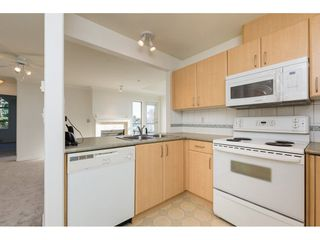 "Photo 8: 404 15325 17 Avenue in Surrey: King George Corridor Condo for sale in ""Berkshire"" (South Surrey White Rock)  : MLS®# R2241475"