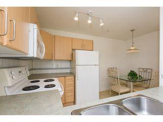 "Photo 11: 404 15325 17 Avenue in Surrey: King George Corridor Condo for sale in ""Berkshire"" (South Surrey White Rock)  : MLS®# R2241475"