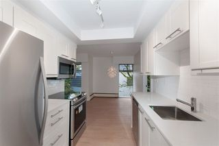 Photo 1: 302 2275 W 40TH Avenue in Vancouver: Kerrisdale Condo for sale (Vancouver West)  : MLS®# R2252384