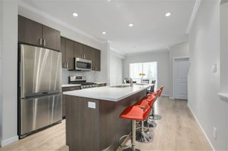 """Main Photo: 4 1111 EWEN Avenue in New Westminster: Queensborough Townhouse for sale in """"English Mews 2"""" : MLS®# R2321511"""