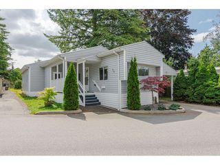 "Photo 1: 79 24330 FRASER Highway in Langley: Otter District Manufactured Home for sale in ""Langley Grove Estates"" : MLS®# R2390843"