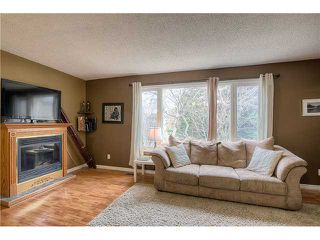 Photo 3: 869 QUEENSLAND Drive SE in CALGARY: Queensland Residential Attached for sale (Calgary)  : MLS®# C3616074