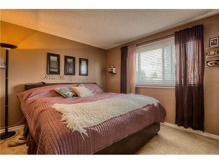 Photo 9: 869 QUEENSLAND Drive SE in CALGARY: Queensland Residential Attached for sale (Calgary)  : MLS®# C3616074