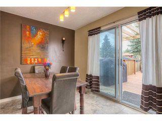 Photo 6: 869 QUEENSLAND Drive SE in CALGARY: Queensland Residential Attached for sale (Calgary)  : MLS®# C3616074