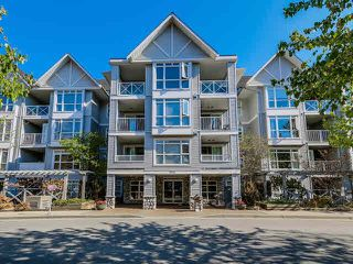"Photo 1: 408 3142 ST JOHNS Street in Port Moody: Port Moody Centre Condo for sale in ""SONRISA IN PORT MOODY"" : MLS®# R2099890"