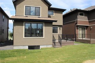 Photo 4: 347 Shawnee Boulevard SW in Calgary: Shawnee Slopes Detached for sale : MLS®# C4198689