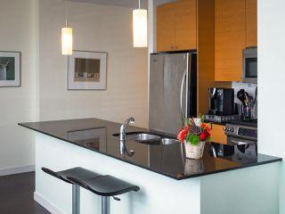 "Photo 2: 304 400 CAPILANO Road in Port Moody: Port Moody Centre Condo for sale in ""ARIA II"" : MLS®# R2306263"