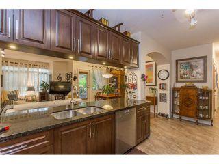 "Photo 5: 118 11887 BURNETT Street in Maple Ridge: East Central Condo for sale in ""WELLINGTON STATION"" : MLS®# R2213469"