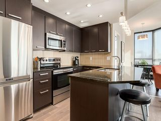 Photo 2: 405 225 11 Avenue SE in Calgary: Beltline Condo for sale : MLS®# C4173203