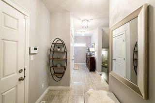 Photo 5: 13831 138 Avenue NW in Edmonton: Zone 27 House Half Duplex for sale : MLS®# E4182465