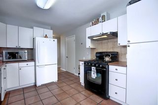 Photo 8: 75 FAIRVIEW Crescent SE in Calgary: Fairview Detached for sale : MLS®# A1057690