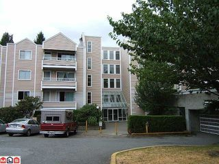 "Photo 1: 406 9644 134TH Street in SURREY: Whalley Condo for sale in ""PARKWOODS ""Fir"""" (North Surrey)  : MLS®# F1120029"