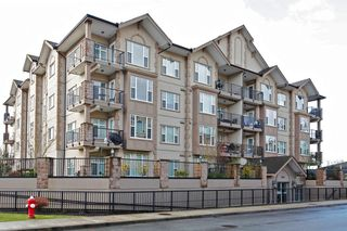 "Photo 1: 204 20286 53A Avenue in Langley: Langley City Condo for sale in ""Casa Verona"" : MLS®# F1428977"