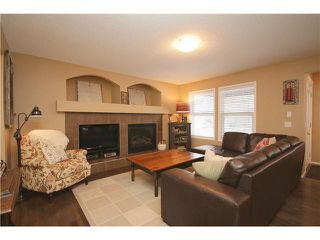 Photo 5: 34 SUNSET Heights: Cochrane House for sale : MLS®# C3652697