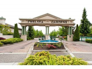 "Photo 1: 128 13888 70TH Avenue in Surrey: East Newton Townhouse for sale in ""Chelsea Gardens"" : MLS®# F1440954"