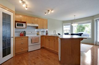 Photo 5: 8 Cougarstone Cove SW in Calgary: House for sale : MLS®# C3622619