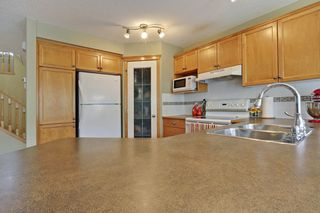 Photo 7: 8 Cougarstone Cove SW in Calgary: House for sale : MLS®# C3622619