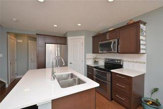 Photo 5: 207 Sunrise View: Cochrane House for sale : MLS®# C4137636
