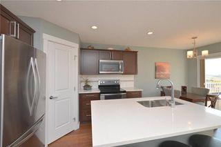 Photo 4: 207 Sunrise View: Cochrane House for sale : MLS®# C4137636