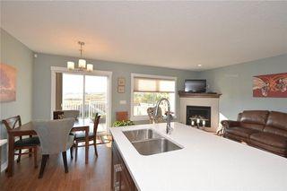 Photo 7: 207 Sunrise View: Cochrane House for sale : MLS®# C4137636