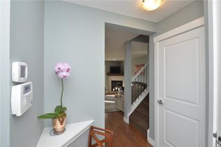 Photo 3: 207 Sunrise View: Cochrane House for sale : MLS®# C4137636
