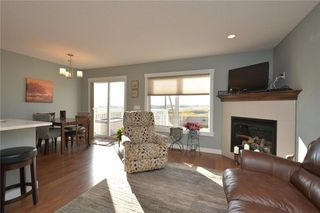 Photo 9: 207 Sunrise View: Cochrane House for sale : MLS®# C4137636