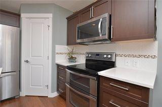 Photo 6: 207 Sunrise View: Cochrane House for sale : MLS®# C4137636