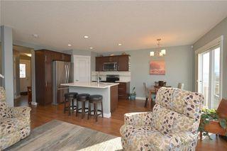 Photo 10: 207 Sunrise View: Cochrane House for sale : MLS®# C4137636