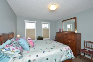 Photo 16: 207 Sunrise View: Cochrane House for sale : MLS®# C4137636