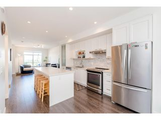 """Photo 6: 101 9989 E BARNSTON Drive in Surrey: Fraser Heights Townhouse for sale in """"Highcrest at Fraser Heights"""" (North Surrey)  : MLS®# R2371201"""