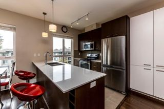 "Photo 2: 401 2473 ATKINS Avenue in Port Coquitlam: Central Pt Coquitlam Condo for sale in ""Valore"" : MLS®# R2373642"