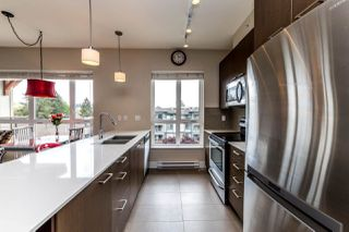 "Photo 3: 401 2473 ATKINS Avenue in Port Coquitlam: Central Pt Coquitlam Condo for sale in ""Valore"" : MLS®# R2373642"
