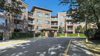 "Photo 1: 112 2559 PARKVIEW Lane in Port Coquitlam: Central Pt Coquitlam Condo for sale in ""THE CRESCENT"" : MLS®# R2396239"