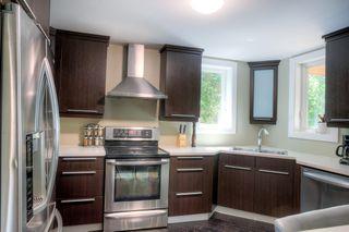 Photo 9: 305 Beaverbrook Street in Winnipeg: Single Family Detached for sale (1C)  : MLS®# 202015362