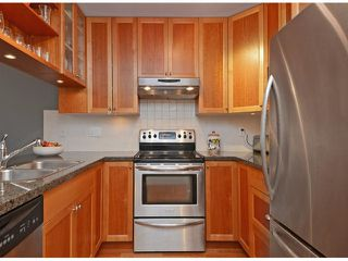 "Photo 2: 404 15368 16A Avenue in Surrey: King George Corridor Condo for sale in ""OCEAN BAY VILLAS"" (South Surrey White Rock)  : MLS®# F1430161"