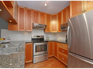 "Photo 3: 404 15368 16A Avenue in Surrey: King George Corridor Condo for sale in ""OCEAN BAY VILLAS"" (South Surrey White Rock)  : MLS®# F1430161"
