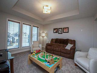 Photo 10: 55 SUNSET Parkway: Cochrane House for sale : MLS®# C3651244