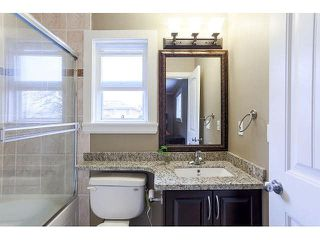 Photo 12: 7981 15TH AVE - LISTED BY SUTTON CENTRE REALTY in Burnaby: East Burnaby 1/2 Duplex for sale (Burnaby East)  : MLS®# V1113496