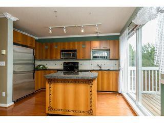 "Photo 7: 111 7179 201ST Street in Langley: Willoughby Heights Townhouse for sale in ""DENIM"" : MLS®# F1447236"