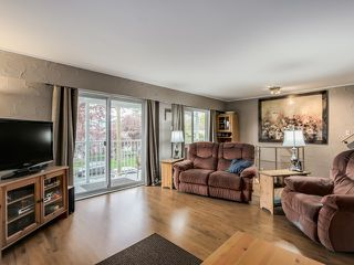 Photo 2: 4656 RAVINE Street in Vancouver: Collingwood VE House for sale (Vancouver East)  : MLS®# R2107811