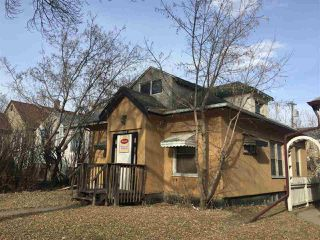Photo 1: 11715 97 Street NW in Edmonton: Zone 05 House for sale : MLS®# E4151249