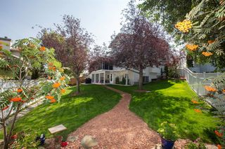 Photo 2: 127 Sandalwood Place NW in Calgary: Sandstone Valley Detached for sale : MLS®# A1048692