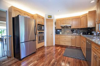Photo 7: 127 Sandalwood Place NW in Calgary: Sandstone Valley Detached for sale : MLS®# A1048692