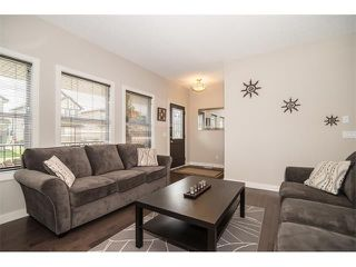 Photo 3: 63 RAVENSKIRK Heath SE: Airdrie House for sale : MLS®# C4027014