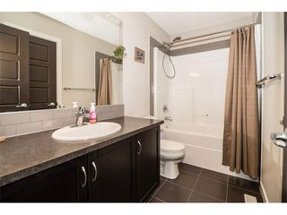 Photo 20: 63 RAVENSKIRK Heath SE: Airdrie House for sale : MLS®# C4027014